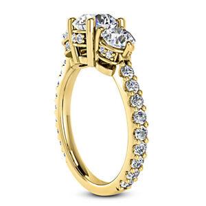 Three Stone 1.57 Carat VS2/H Round Diamond Engagement Ring Yellow Gold Enhanced