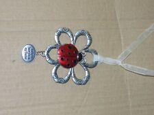 Cute silver tone metal & Enamel Ladybug on a flower Teacher Ornament