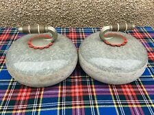 A superb pair of Ailsa Craig 'Blue Hone' Scots Curling Stones dated 1909