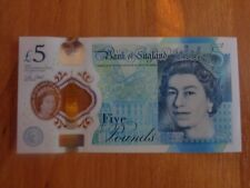 New polymer 5 pounds note AK 47 160673 in excellent condition