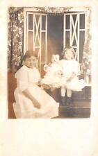 RPPC CHILDREN WITH KEWPIE DOLL DETROIT MICHIGAN REAL PHOTO POSTCARD (c. 1910)