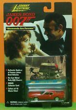 JOHNNY LIGHTNING JAMES BOND 007 - FORD MUSTANG MACH 1 -DIAMONDS + BUGGY CARD MOC