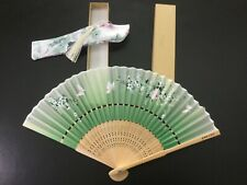 Traditional classical hand-made fan, realistic pattern, gift souvenir, green.