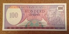 Suriname banconota. 100 GULDEN. FIOR. DATATO 1985.