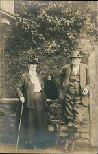 Old Lady & Gentleman with dog sitting on wall vintage postcard    QR475