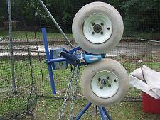 pitching machine jugs with a 14' x 70' heavy duty batting net.