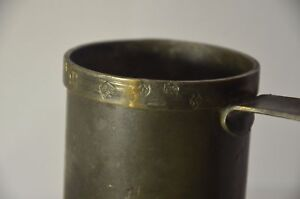 Antique cup. Antique measuring cup for milk.  USSR. 1920-30. Tin