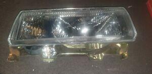 NISSAN BLUEBIRD 910 MODEL RH Left hand Head Lamp / light with housing NOS
