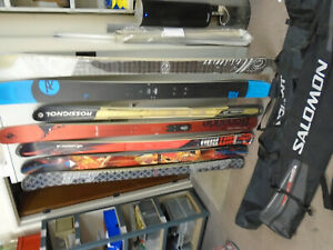 7 pairs Scott , Rossignol , Nordica , Blizzard Skis with 2 bags