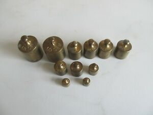 VINTAGE GROUPE OF ELEVEN BRASS SCIECE BALANCE SCALE MILK CHURN STYLE WEIGHTS.
