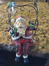 Adorable Santa On A Swing Shelf Figurine