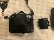 Canon A-1 SLR 35mm Camera with Two Lenses and a Flash