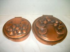 Pair of Round Lidded Copper Boxes, Floral Design on Top