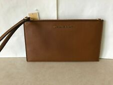 NWT Michael Kors Jet Set Item Large Zip Pebbled Leather Clutch Wrstlt