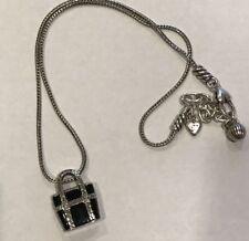 Brighton necklace with a handbag pendant, silver tone