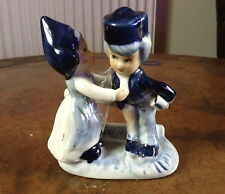 Vintage Delftware boy and girl