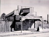 POSTCARD REPRODUCTION FROM OLD PHOTOGRAPH GENERAL STORE WITH LOTS OF SIGNS