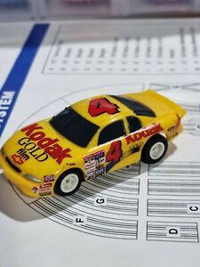 AFX TOMY CHEVY MONTE CARLO #4 SLOT CAR