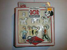 Boite de figurines Disney 101 DALMATIEN KID'M en carton .Boite et support abîmés