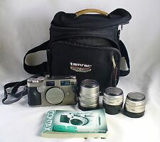 Fine vintage Contax G2 camera w/ Zeiss 2.8/28, 2/45, 2.8/90 lenses manual case