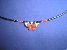 collar con circonita coral y otra piedra forma mariposa nueva