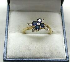 Lovely Gold Gilded Silver Blue Topaz And Diamond Flower Shaped Ring
