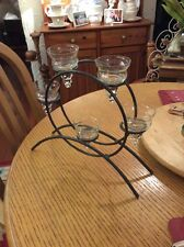 A BLACK AND SILVER METAL STAND WITH 5 GLASS HOLDERS#F/R