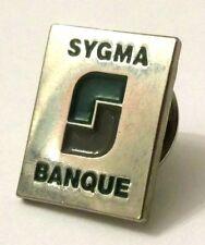 Pin Spilla Sygma Banque