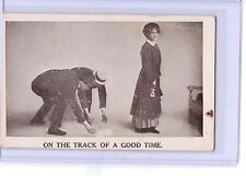 VINTAGE RISQUE MEN ON THE TRACK OF A GOOD TIME POSTCARD