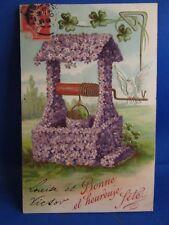 cpa  illustrateur le puit de violettes fleurs gaufré