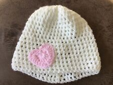 Handmade baby girl's wool hat. White with pink heart motif