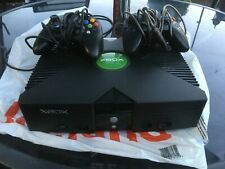 Original xbox console with two controllers.