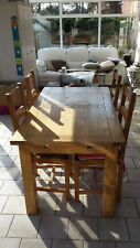 Solid oak dining table and 4 chairs with cushions