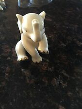 Nice Lenox Classic Collection porcelain sitting baby elephant with gold accents.