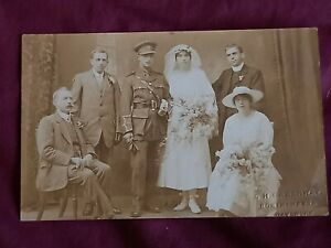 VINTAGE WW 1 ERA REAL PHOTO POSTCARD YOUNG SOLDIER IN UNIFORM. WEDDING DAY PHOTO