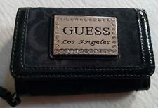 GUESS Wristlet - Black holds IPHONE 4