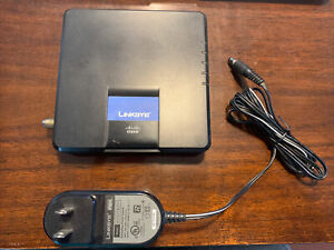 Cisco-Linksys Cable Modem CM100 USB Ethernet Connections - With Power Cord