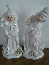 two porcelain clowns with gold trim