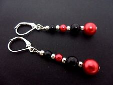 A PAIR OF DANGLY RED & BLACK GLASS PEARL LEVERBACK HOOK  EARRINGS.