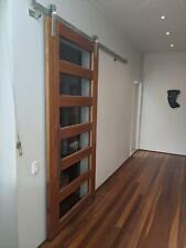 Solid timber sliding door, designer handles and Centor rail syste