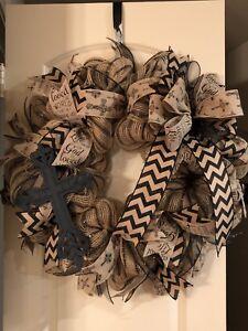Handmade deco mesh religious wreath.