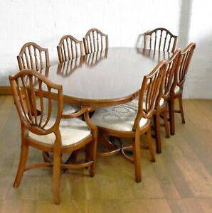 Antique style extending dining table and set of 8 chairs