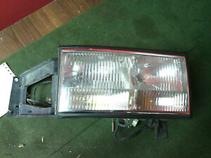 1994 - 1996 Cadillac Deville  LH(driver) headlight & mount bracket OEM