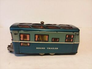"""VINTAGE TIN LITHOGRAPH TOY HOUSE TRAILER W/FULL LITHO INTERIOR JAPAN 10"""" LONG."""