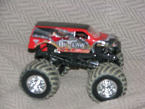HOT WHEELS MONSTER JAM IRON OUTLAW RED TRUCK 1:64 SCALE PLASTIC BASE