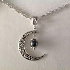 collier pendentif croissant de lune et perle en hématite