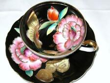 OCCUPIED JAPAN 3 FOOTED PINK FLORAL BUTTERFLY BLACK TEA CUP AND SAUCER