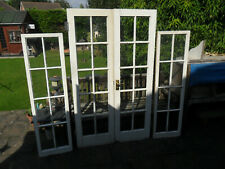 Wooden French Doors and Side Windows
