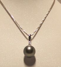 Brand new black Tahitian Pearl Pendant set in 18k solid white gold.