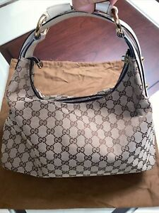Authentic Gucci Classic Canvas hobo shoulder bag. Storage Bag Included.